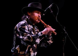 Musician Adrian Villanueva plays a quena (Andean flute) during a ceremony in La Paz