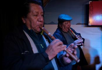 Musicians play quenas (Andean flutes) during a ceremony in La Paz