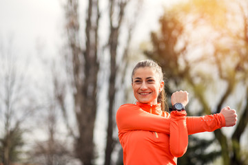 Sporty woman doing arms exercise.Portrait of woman doing exercise before training