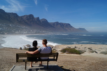 Couple overlooking Camps Bay and the Twelve Apostles, South Africa