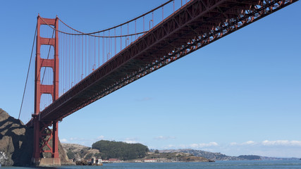 View towards the northern tower of Golden Gate Bridge, from beneath, on the Pacific Ocean side, captured from a ferryboat connecting Sausalito to San Francisco, California, USA