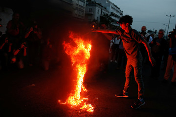 A protester burns an U.S. flag during a demonstration outside the U.S. embassy against air strikes carried out in Syria