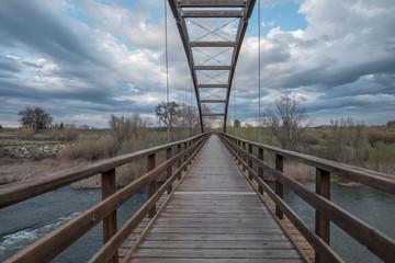 wooden bridge cross river