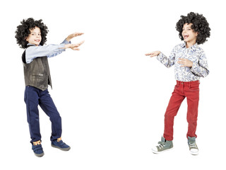 Little boys pointing empty copy space. Isolated on white background