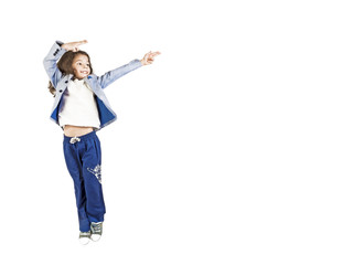 Image of excited emotional long-haired boy preschooler jumping isolated over white background wall pointing to copyspace.