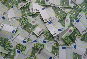 Scattered 100 euro banknotes - background.