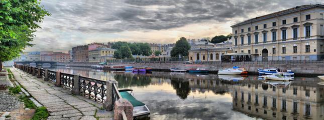 Embankment of the Fontanka river in St. Petersburg at dawn