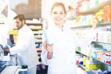 Woman pharmacist working in pharmacy