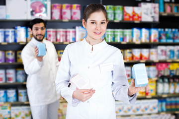 pharmacist who is standing with medicine
