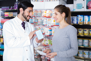 pharmacist is recommending medicine for  woman