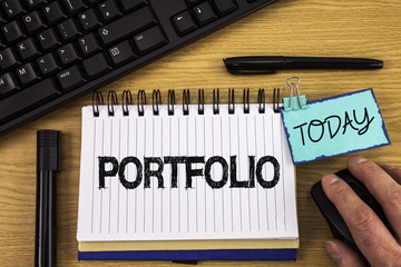 Text sign showing Portfolio. Conceptual photo Examples of work used to apply for a job Combination of shares written on Noteoad on wooden background Hand on Mouse Today Pen Keyboard