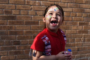 Oishi Rahman, a Bangladeshi American, smiles at her mother during celebrations for the Bengali New Year in Jackson Heights, Queens, New York