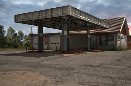 Abandoned old gas station, sunny summer day.