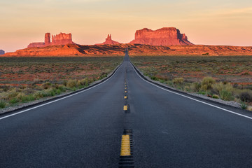 Straight Road vanishing into Monument Valley
