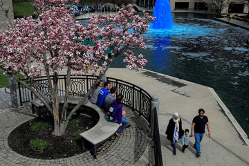 People go about their day at the central canal in Indianapolis, Indiana
