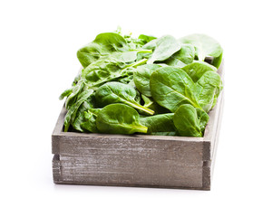 Spinach  leafs in wooden box isolated on white background