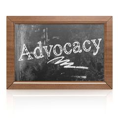 Advocacy text written on blackboard