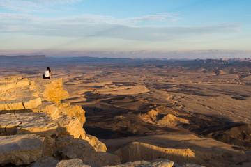 Woman sitting at Makhtesh Ramon