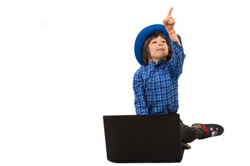 Little boy with laptop pointing away