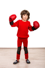 Cute boy with boxing gloves showing fists
