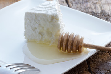 Tasty fresh cow Ricotta cheese with honey