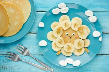 Fun animal shaped pancake with banana, sheep pancake