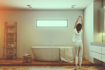 Woman in a luxury bathroom