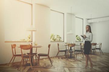 White loft restaurant interior, side view, woman