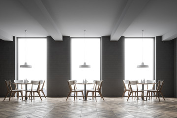 Interior of a gray brick loft cafe
