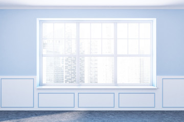 Empty room with blue walls and big window