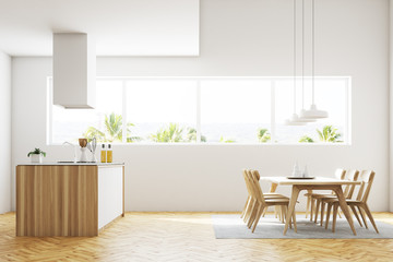 White kitchen and dining room interior side view