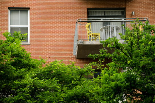 Balcony with yellow chair on Second Street