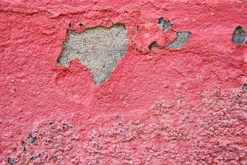 peeling plaster of color on cement wall