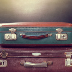 big and small retro memories/ two old worn suitcases for traveling