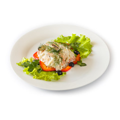 Seafood salad on a white plate. Isolated
