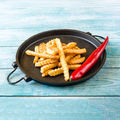fried French fries in a pan
