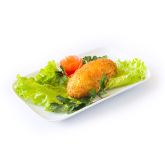Chicken cutlet with herbs on a white plate. Isolated