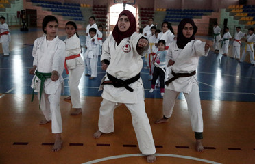 Palestinian karate coach Samah Shaheen, 39, teaches girls a karate lesson, in Salfit in the occupied West Bank