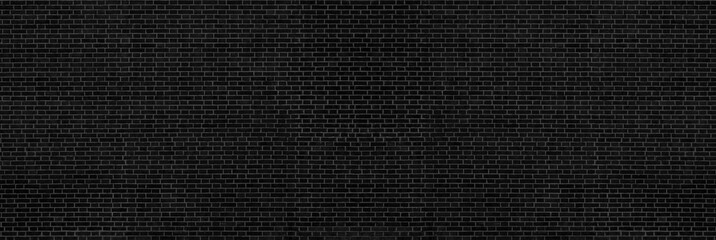 Wide black brick wall texture - spacious dark brickwork background