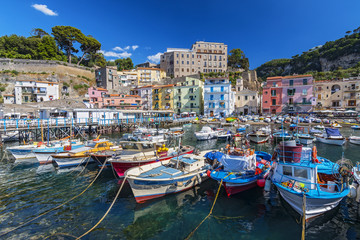 Small fishing boats at harbor Marina Grande in Sorrento, Campania, Amalfi Coast, Italy.