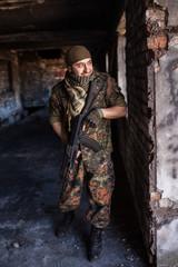 The Arab soldier with the AK-47 Kalashnikov assault rifle