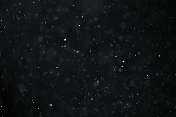 abstract real dust floating over black background for overlay