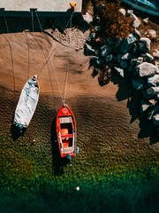 Aerial view of a wooden fishing boats in the sea.