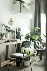 Working corner in apartment with Scandinavian style decoration and artificial plants in background / Cozy Interior Concept / Cozy Working corner