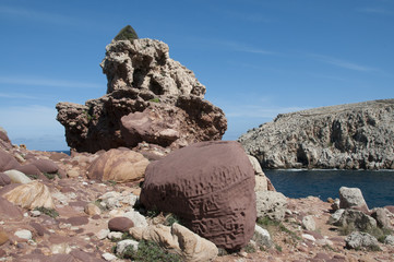 Rocks of curious shapes in Cala Morell, Menorca, Balearic Islands, Spain