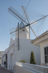Street with windmill in Sant Lluis, Menorca, Balearic Islands, Spain