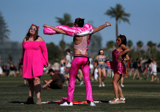 Concertgoers dance at the Coachella Valley Music and Arts Festival in Indio