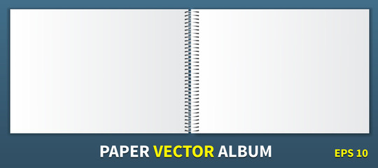 Paper album with a metal spiral in the center. Horizontal Blank Cover for Inserting Images is a template. Lie down on the table, open to both sides. Isolated on blue background, vector.