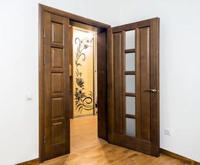 New brown wooden door in house interior