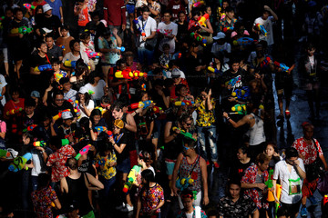 People play with water, during Songkran Water Festival celebrations, to commemorate the Thai New Year in Bangkok
